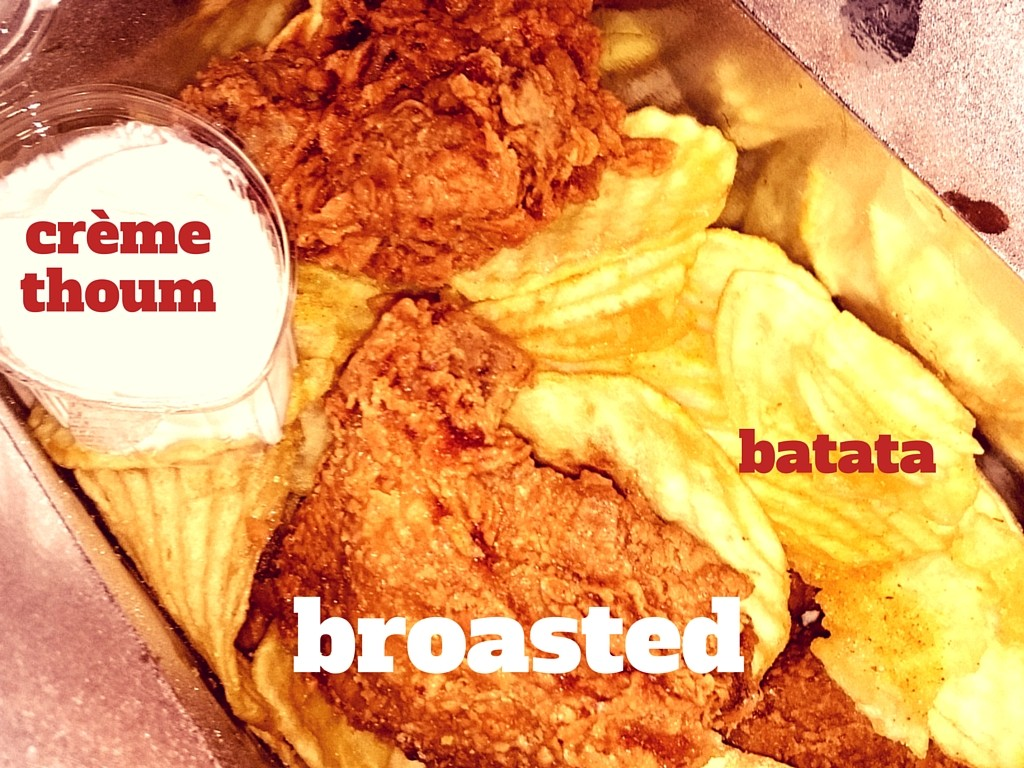 Broasted (fried chicken) with potato fries and garlic cream